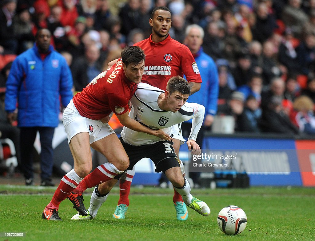 <a gi-track='captionPersonalityLinkClicked' href=/galleries/search?phrase=Johnnie+Jackson&family=editorial&specificpeople=853675 ng-click='$event.stopPropagation()'>Johnnie Jackson</a> of Charlton Athletic battles with Aaron Cresswell of Ipswich during the npower Championship match between Charlton Athletic and Ipswich Town at The Valley on December 26, 2012 in London, England.