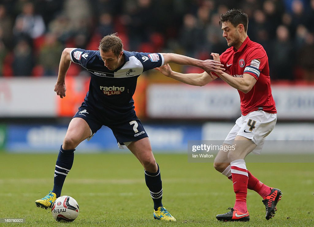 Johnnie Jackson (R) of Charlton Athletic tries to tackle Rob Hulse of Millwall during the npower Championship match between Charlton Athletic and Millwall at The Valley on March 16, 2013 in London, England.