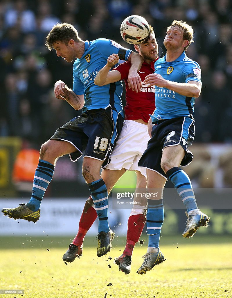 Johnnie Jackson of Charlton battles for and aerial ball with Michael Tonge (L) and Paul Green (R) of Leeds during the npower Championship match between Charlton Athletic and Leeds United at the Valley on April 06, 2013 in London, England.