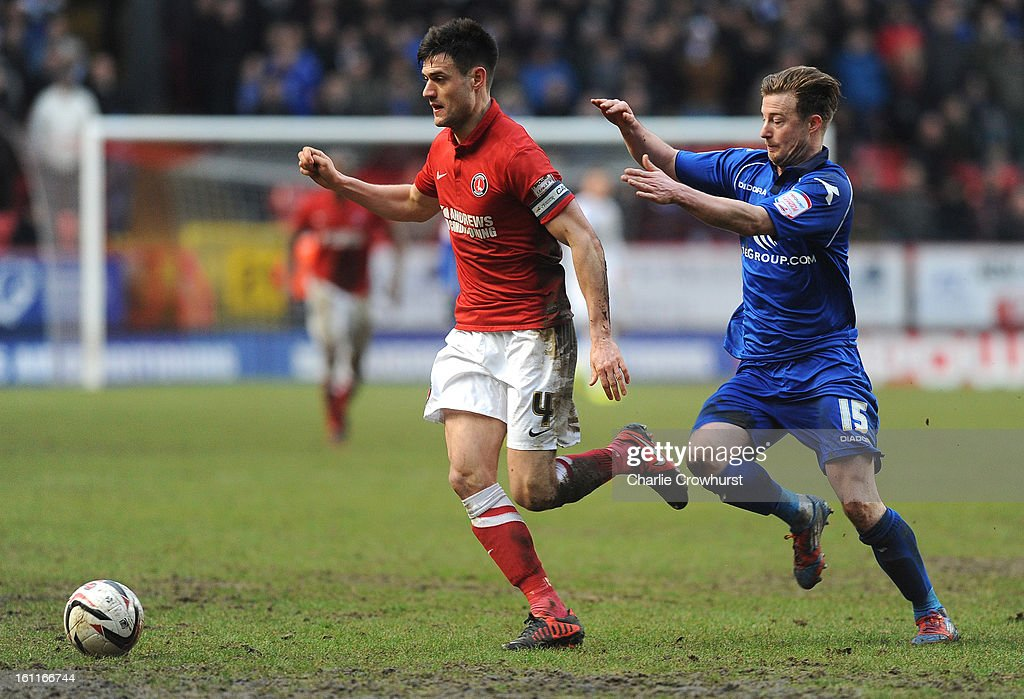 Johnnie Jackson of Charlton gets away from Birmingham's Wade Elliot during the npower Championship match between Charlton Athletic and Birmingham City at The Valley on February 09, 2013 in London England.