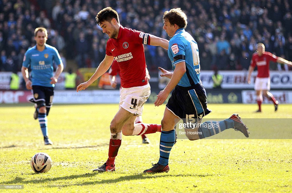 Johnnie Jackson of Charlton holds off the challenge of Stephen Warnock of Leeds during the npower Championship match between Charlton Athletic and Leeds United at the Valley on April 06, 2013 in London, England.