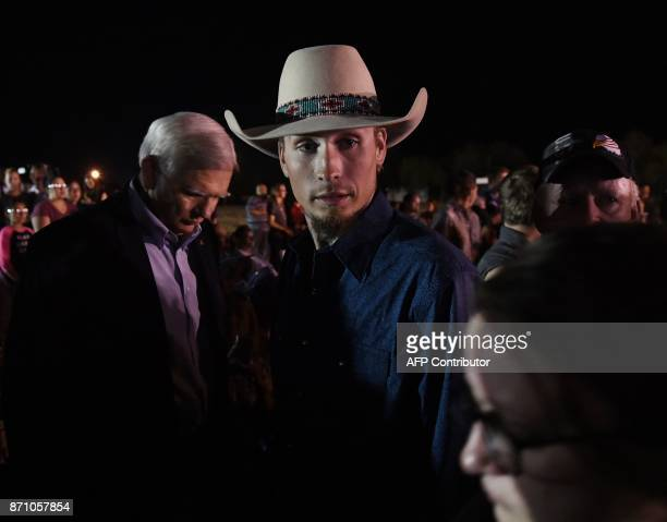Johnnie Langendorff one of the two men who chased after suspected killer Devin Kelley looks on during a vigil in Sutherland Springs Texas on November...