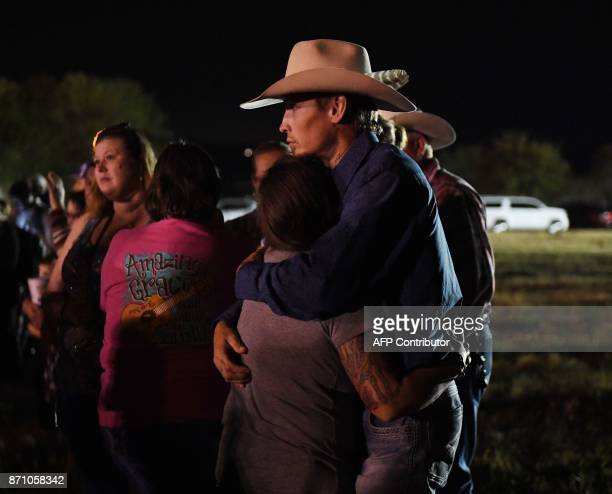 Johnnie Langendorff one of the two men who chased after suspected killer Devin Kelley hugs a woman during a vigil in Sutherland Springs Texas on...