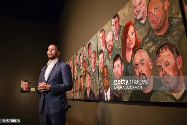 Johnnie Yellock US Air Force Staff Sergeant stands in front of a painting of him painted by former US President George W Bush for the 'Portraits of...