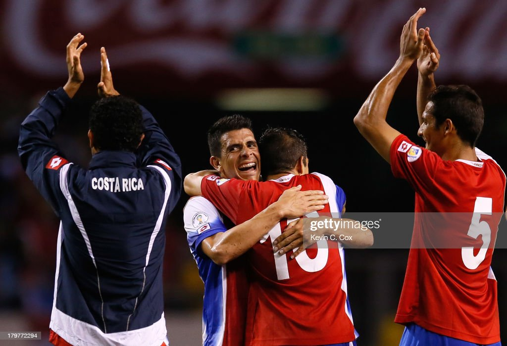 Johnny Acosta #2 and Christian Gamboa #16 celebrate their 3-1 win over the United States during the FIFA 2014 World Cup Qualifier at Estadio Nacional on September 6, 2013 in San Jose, Costa Rica.