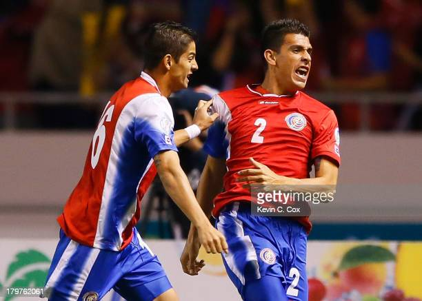 Johnny Acosta celebrates scoring the first goal against the United States with Christian Gamboa during the FIFA 2014 World Cup Qualifier at Estadio...