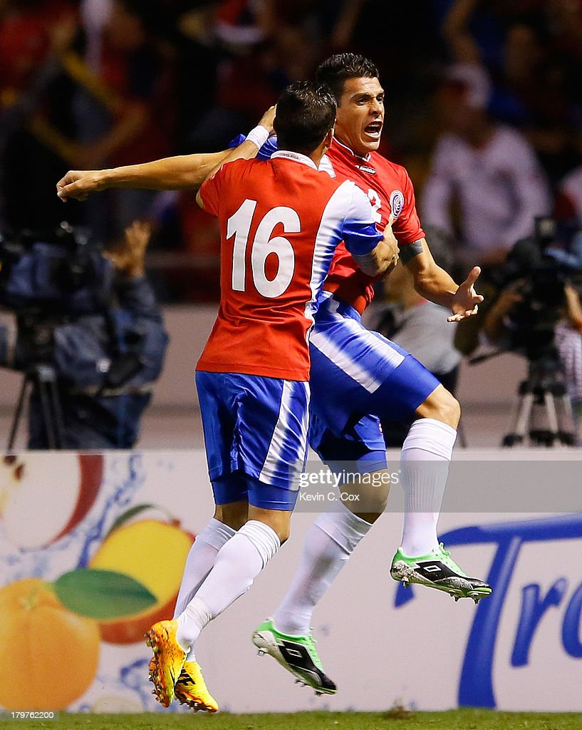Johnny Acosta #2 celebrates scoring the first goal against the United States with Christian Gamboa #16 during the FIFA 2014 World Cup Qualifier at Estadio Nacional on September 6, 2013 in San Jose, Costa Rica.