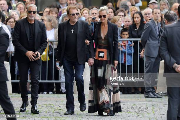 Johnny and Laetitia Hallyday attend Mireille Darc's Funerals at Eglise SaintSulpice on September 1 2017 in Paris France