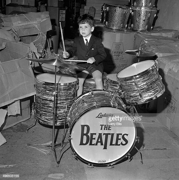 Johnny Arbiter the son of an importer playing a miniature set of 'The Beatles' drums imported by Ringo Starr from Chicago May 28th 1964