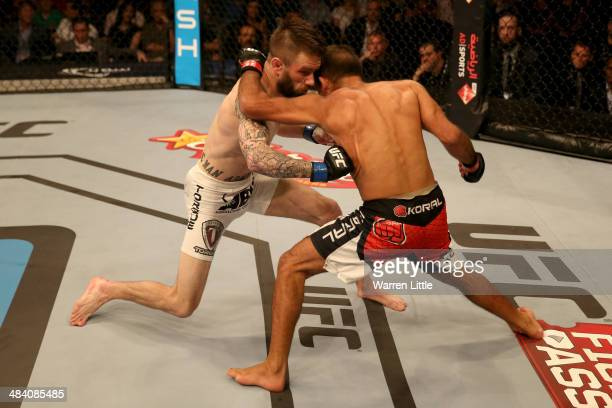 Johnny Bedford connects with a right punch to the side of Rani Yahya in the first round during their bout during UFC Fight Night 39 at du Arena on...
