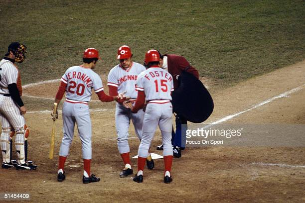 Johnny Bench of the Cincinnati Reds is congratulated by his teammates Cesar Geronimo and George Foster during the World Series against the New York...