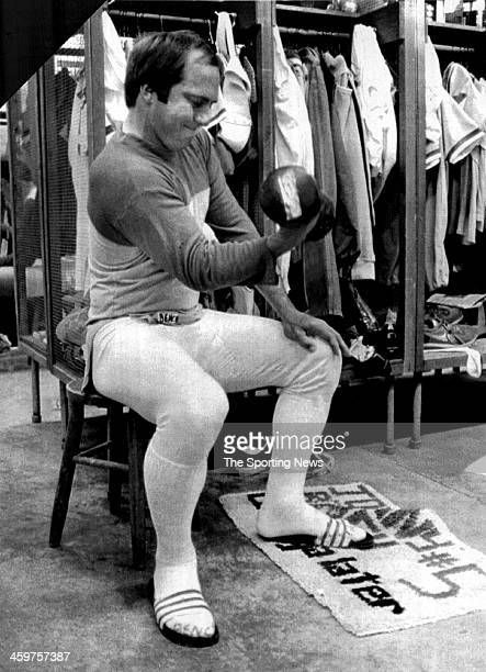 Johnny Bench of the CIncinnati Reds works on his throwing arm by lifting weights before practice on March 3 1982 in Tampa Florida