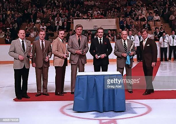 Johnny Bower Dick Duff Ron Ellis Allen Stanley Norm Ullman and King Clancy of the Toronto Maple Leafs are presented with awards from NHL President...
