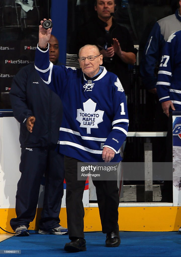 Johnny Bower walks onto the ice before NHL action at the Air Canada Centre January 21, 2013 in Toronto, Ontario, Canada.