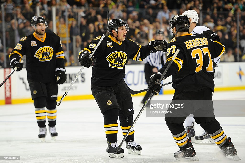 Johnny Boychuk #55, <a gi-track='captionPersonalityLinkClicked' href=/galleries/search?phrase=Brad+Marchand&family=editorial&specificpeople=2282544 ng-click='$event.stopPropagation()'>Brad Marchand</a> #63 and <a gi-track='captionPersonalityLinkClicked' href=/galleries/search?phrase=Patrice+Bergeron&family=editorial&specificpeople=204162 ng-click='$event.stopPropagation()'>Patrice Bergeron</a> #37 of the Boston Bruins celebrate a goal against the Los Angeles Kings at the TD Garden on January 20, 2014 in Boston, Massachusetts.