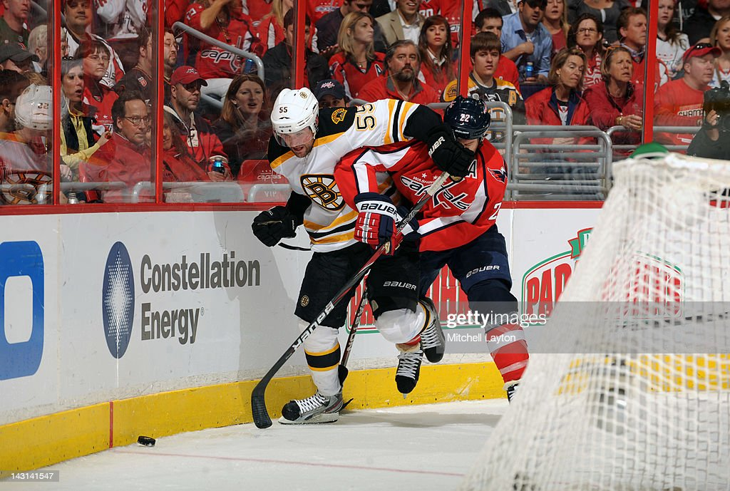 <a gi-track='captionPersonalityLinkClicked' href=/galleries/search?phrase=Johnny+Boychuk&family=editorial&specificpeople=2125695 ng-click='$event.stopPropagation()'>Johnny Boychuk</a> #55 of the Boston Bruins and <a gi-track='captionPersonalityLinkClicked' href=/galleries/search?phrase=Mike+Knuble&family=editorial&specificpeople=202077 ng-click='$event.stopPropagation()'>Mike Knuble</a> #22 of the Washington Capitals fight for a loose puck during Game Four of the Eastern Conference Quarterfinals of the 2012 NHL Stanley Cup Playoffs on April 19, 2012 at the Verizon Center in Washington, DC.