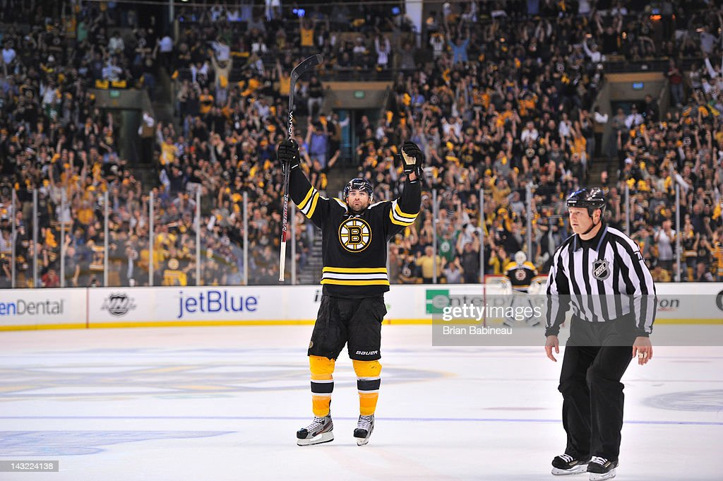 Johnny Boychuk #55 of the Boston Bruins celebrates a goal to tie the game against the Washington Capitals in Game Five of the Eastern Conference Quarterfinals during the 2012 NHL Stanley Cup Playoffs at TD Garden on April 21, 2012 in Boston, Massachusetts.