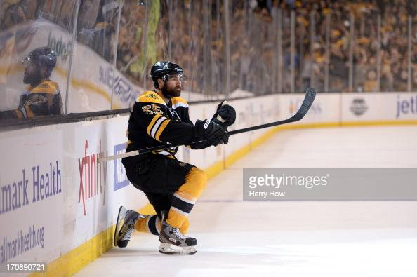 Johnny Boychuk of the Boston Bruins celebrates after scoring a goal in the third period against the Chicago Blackhawks in Game Four of the 2013 NHL...
