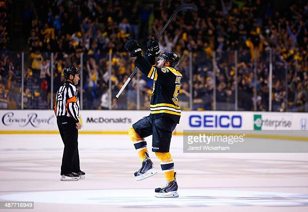 Johnny Boychuk of the Boston Bruins celebrates his goal in the third period against the Montreal Canadiens to force overtime in Game One of the...