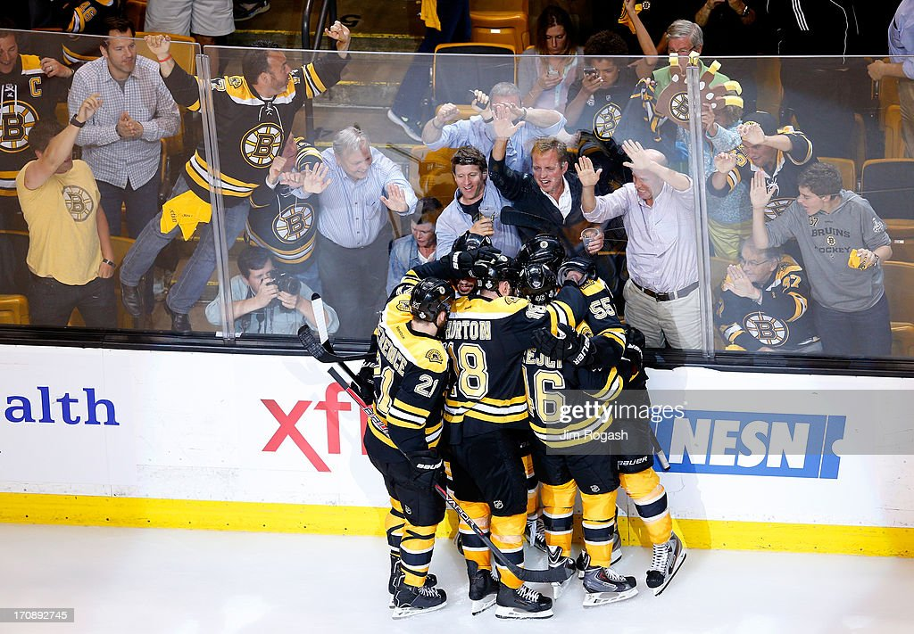 Johnny Boychuk #55 of the Boston Bruins celebrates with Andrew Ference #21, David Krejci #46, Kaspars Daugavins #16 and Nathan Horton #18 after scoring a goal in the third period against the Chicago Blackhawks in Game Four of the 2013 NHL Stanley Cup Final at TD Garden on June 19, 2013 in Boston, Massachusetts.