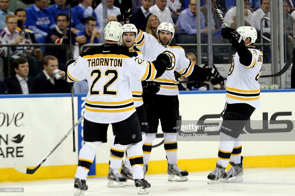 <a gi-track='captionPersonalityLinkClicked' href=/galleries/search?phrase=Johnny+Boychuk&family=editorial&specificpeople=2125695 ng-click='$event.stopPropagation()'>Johnny Boychuk</a> #55 of the Boston Bruins celebrates with teammates <a gi-track='captionPersonalityLinkClicked' href=/galleries/search?phrase=Shawn+Thornton&family=editorial&specificpeople=221639 ng-click='$event.stopPropagation()'>Shawn Thornton</a> #22, <a gi-track='captionPersonalityLinkClicked' href=/galleries/search?phrase=Daniel+Paille&family=editorial&specificpeople=706561 ng-click='$event.stopPropagation()'>Daniel Paille</a> and <a gi-track='captionPersonalityLinkClicked' href=/galleries/search?phrase=Matt+Bartkowski&family=editorial&specificpeople=7203779 ng-click='$event.stopPropagation()'>Matt Bartkowski</a> #43 after scoring a goal in the third period to tie the score 1-1 against Henrik Lundqvist #30 of the New York Rangers in Game Three of the Eastern Conference Semifinals during the 2013 NHL Stanley Cup Playoffs at Madison Square Garden on May 21, 2013 in New York City.