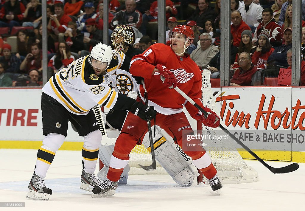 <a gi-track='captionPersonalityLinkClicked' href=/galleries/search?phrase=Johnny+Boychuk&family=editorial&specificpeople=2125695 ng-click='$event.stopPropagation()'>Johnny Boychuk</a> #55 of the Boston Bruins does battle with <a gi-track='captionPersonalityLinkClicked' href=/galleries/search?phrase=Justin+Abdelkader&family=editorial&specificpeople=2271858 ng-click='$event.stopPropagation()'>Justin Abdelkader</a> #8 of the Detroit Red Wings in front of goalie <a gi-track='captionPersonalityLinkClicked' href=/galleries/search?phrase=Tuukka+Rask&family=editorial&specificpeople=716723 ng-click='$event.stopPropagation()'>Tuukka Rask</a> #44 during the first period of the game at Joe Louis Arena on November 27, 2013 in Detroit, Michigan.