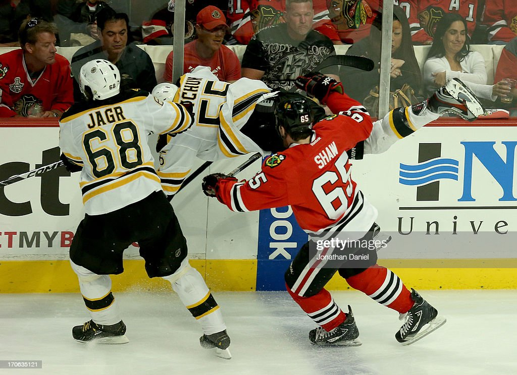 <a gi-track='captionPersonalityLinkClicked' href=/galleries/search?phrase=Johnny+Boychuk&family=editorial&specificpeople=2125695 ng-click='$event.stopPropagation()'>Johnny Boychuk</a> #55 of the Boston Bruins flys through the air against the Chicago Blackhawks in Game Two of the NHL 2013 Stanley Cup Final at United Center on June 15, 2013 in Chicago, Illinois.
