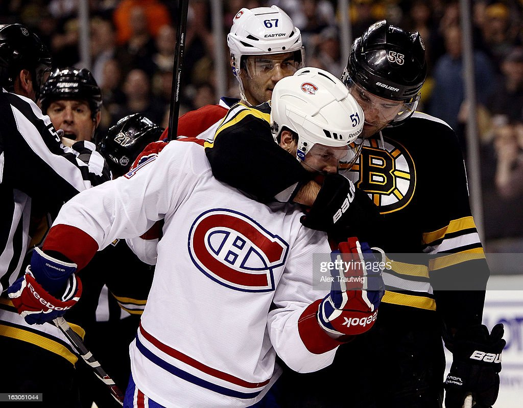 Johnny Boychuk #55 of the Boston Bruins grabs David Desharnais #51 of the Montreal Canadiens after the whistle during a game at the TD Garden on March 3, 2013 in Boston, Massachusetts.