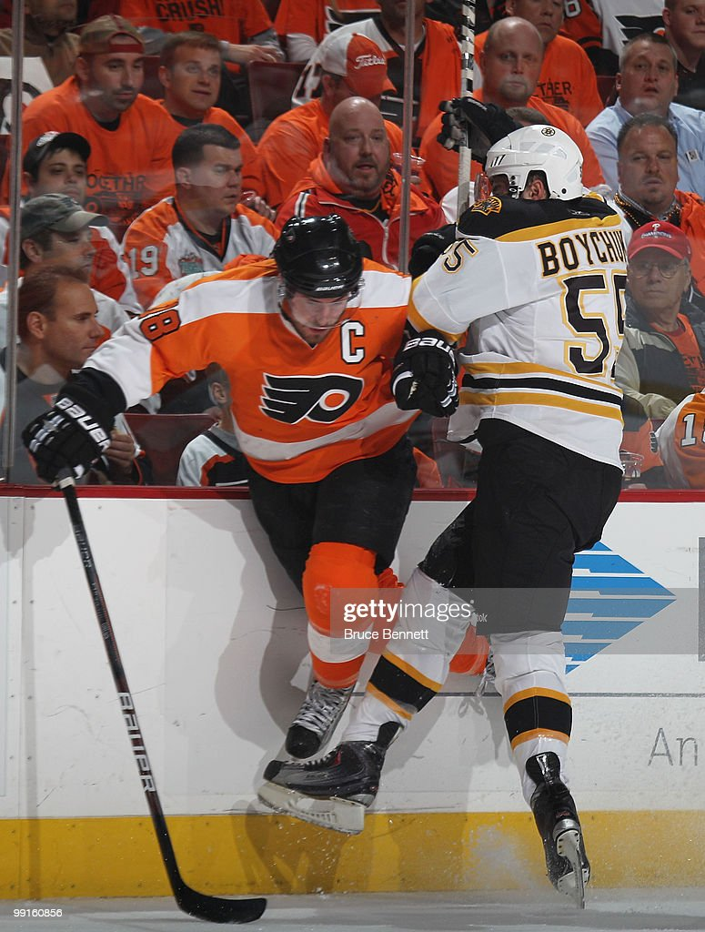 Johnny Boychuk #55 of the Boston Bruins hits Mike Richards #18 of the Philadelphia Flyers in Game Six of the Eastern Conference Semifinals during the 2010 NHL Stanley Cup Finals at the Wachovia Center on May 12, 2010 in Philadelphia, Pennsylvania.