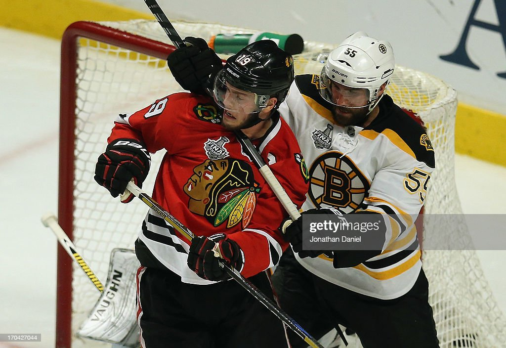 <a gi-track='captionPersonalityLinkClicked' href=/galleries/search?phrase=Johnny+Boychuk&family=editorial&specificpeople=2125695 ng-click='$event.stopPropagation()'>Johnny Boychuk</a> #55 of the Boston Bruins hooks <a gi-track='captionPersonalityLinkClicked' href=/galleries/search?phrase=Jonathan+Toews&family=editorial&specificpeople=537799 ng-click='$event.stopPropagation()'>Jonathan Toews</a> #19 of the Chicago Blackhawks around the necxk with his stick during Game One of the 2013 NHL Stanley Cup Finals at United Center on June 12, 2013 in Chicago, Illinois. The Blackhawks defeated the Bruins 4-3 in triple overtime.