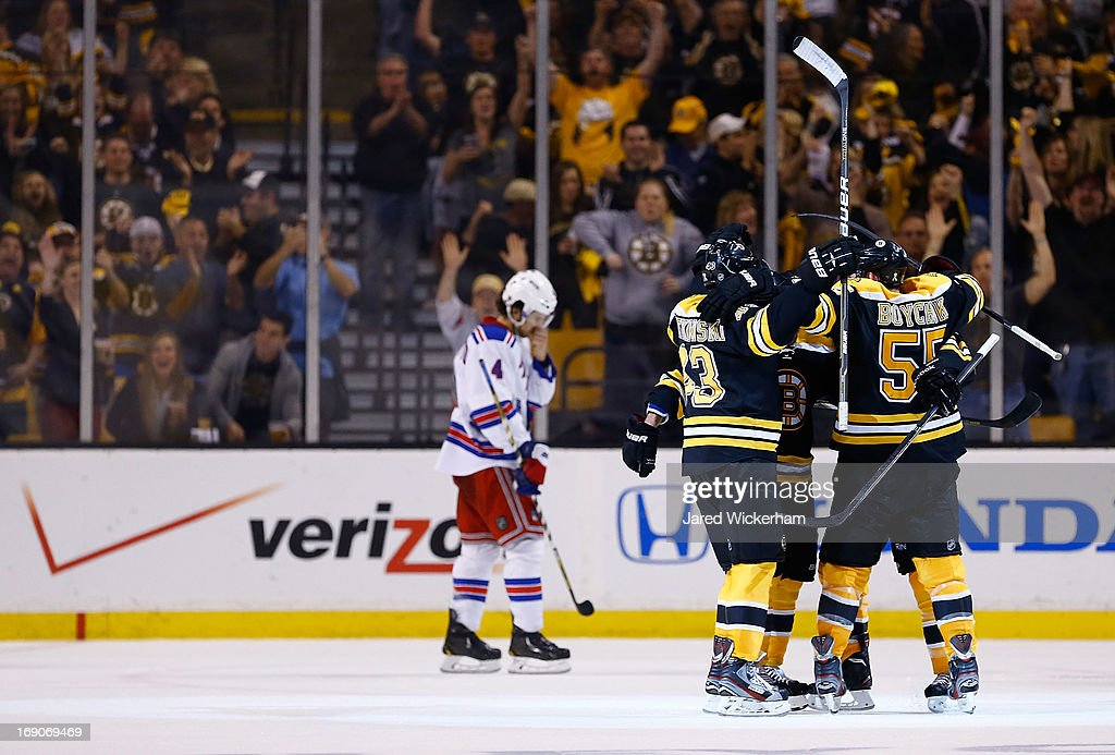 Johnny Boychuk #55 of the Boston Bruins is congratulated by teammates after scoring a goal in the second period against the New York Rangers in Game Two of the Eastern Conference Semifinals during the 2013 NHL Stanley Cup Playoffs on May 19, 2013 at TD Garden in Boston, Massachusetts.