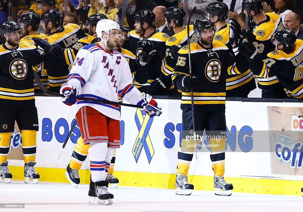 Johnny Boychuk #55 of the Boston Bruins is congratulated by teammates on the bench after scoring a goal in the second period against the New York Rangers in Game Two of the Eastern Conference Semifinals during the 2013 NHL Stanley Cup Playoffs on May 19, 2013 at TD Garden in Boston, Massachusetts.