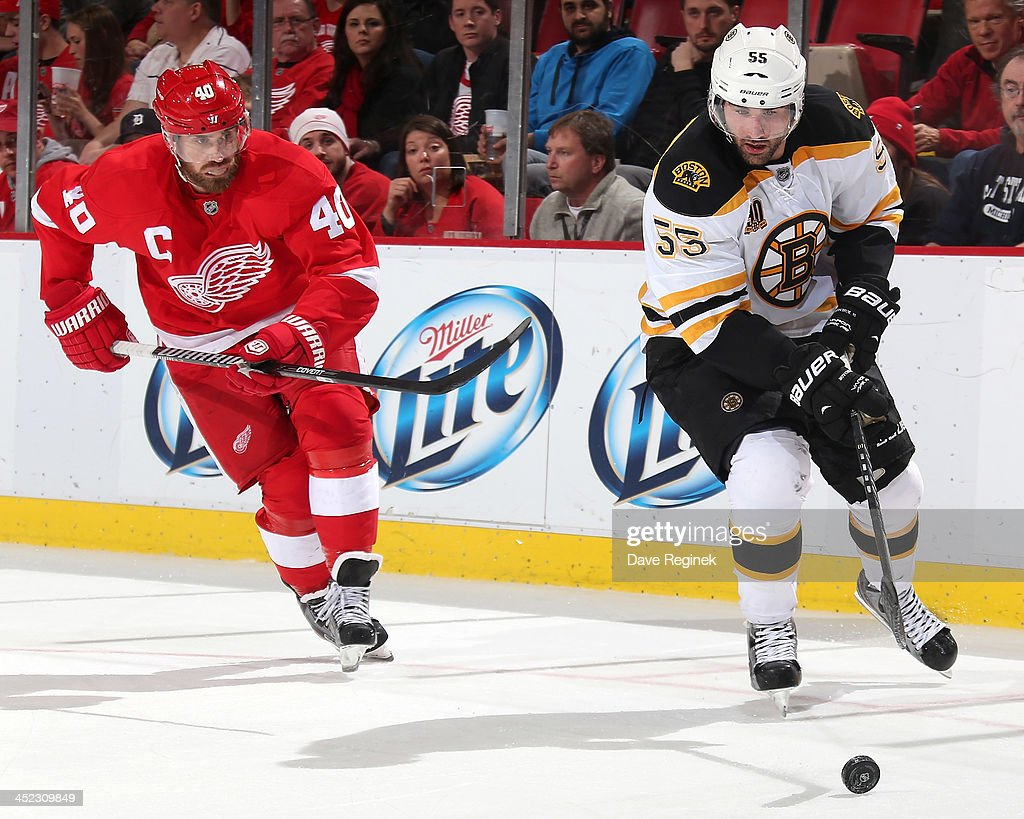 <a gi-track='captionPersonalityLinkClicked' href=/galleries/search?phrase=Johnny+Boychuk&family=editorial&specificpeople=2125695 ng-click='$event.stopPropagation()'>Johnny Boychuk</a> #55 of the Boston Bruins skates with the puck as <a gi-track='captionPersonalityLinkClicked' href=/galleries/search?phrase=Henrik+Zetterberg&family=editorial&specificpeople=201520 ng-click='$event.stopPropagation()'>Henrik Zetterberg</a> #40 of the Detroit Red Wings gives chase during an NHL game at Joe Louis Arena on November 27, 2013 in Detroit, Michigan. Detroit defeated Boston 6-1