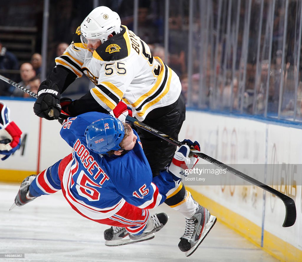 Johnny Boychuk #55 of the Boston Bruins throws a hit on Derek Dorsett #15 of the New York Rangers in Game Four of the Eastern Conference Semifinals during the 2013 NHL Stanley Cup Playoffs at Madison Square Garden on May 23, 2013 in New York City.