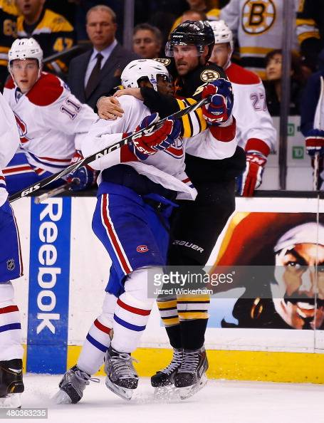 Johnny Boychuk of the Boston Bruins throws down PK Subban of the Montreal Canadiens in the second period during the game at TD Garden on March 24...