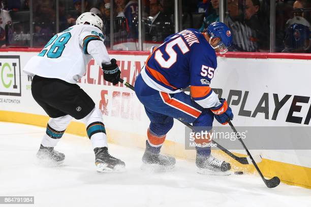 Johnny Boychuk of the New York Islanders batles for the puck with Timo Meier of the San Jose Sharks at Barclays Center on October 21 2017 in New York...