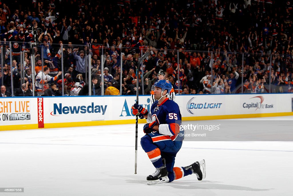<a gi-track='captionPersonalityLinkClicked' href=/galleries/search?phrase=Johnny+Boychuk&family=editorial&specificpeople=2125695 ng-click='$event.stopPropagation()'>Johnny Boychuk</a> #55 of the New York Islanders celebrates after scoring the game-winning goal in overtime against the Washington Capitals during a game at the Nassau Veterans Memorial Coliseum on December 29, 2014 in Uniondale, New York.
