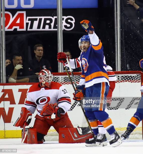 Johnny Boychuk of the New York Islanders celebrates first period goal by Nick Leddy against Scott Darling of the Carolina Hurricanes at the Barclays...