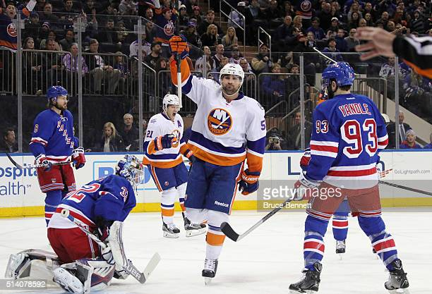 Johnny Boychuk of the New York Islanders celebrates his goal at 250 of the first period against Antti Raanta of the New York Rangers at Madison...