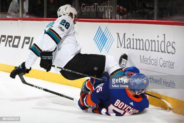 Johnny Boychuk of the New York Islanders collides with Timo Meier of the San Jose Sharks at Barclays Center on October 21 2017 in New York City