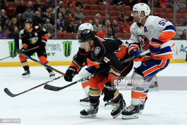 Johnny Boychuk of the New York Islanders defends against Cam Fowler of the Anaheim Ducks during the third period of a game at Honda Center on October...