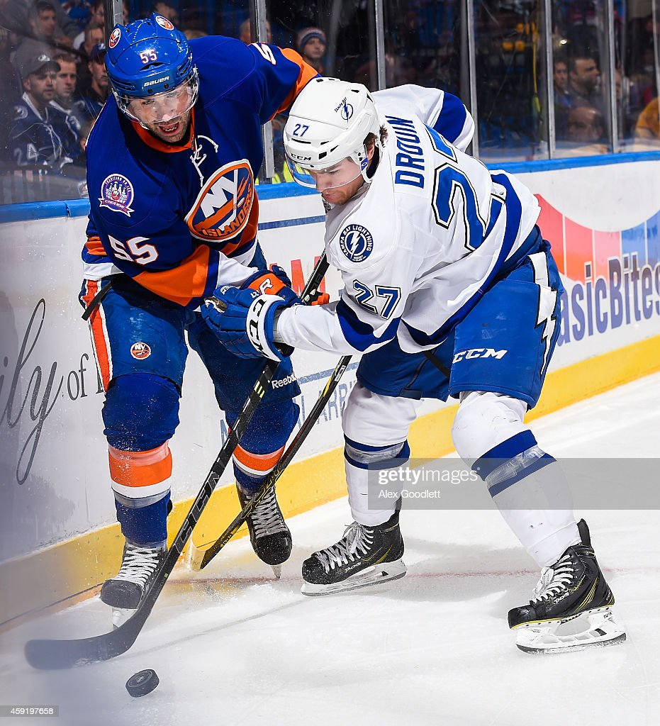<a gi-track='captionPersonalityLinkClicked' href=/galleries/search?phrase=Johnny+Boychuk&family=editorial&specificpeople=2125695 ng-click='$event.stopPropagation()'>Johnny Boychuk</a> #55 of the New York Islanders fights for the puck with <a gi-track='captionPersonalityLinkClicked' href=/galleries/search?phrase=Jonathan+Drouin+-+Ice+Hockey+Player&family=editorial&specificpeople=10884241 ng-click='$event.stopPropagation()'>Jonathan Drouin</a> #27 of the Tampa Bay Lightning in the first period at Nassau Veterans Memorial Coliseum on November 18, 2014 in Uniondale, New York.