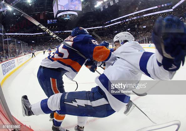 Johnny Boychuk of the New York Islanders hits Alex Killorn of the Tampa Bay Lightning during the third period at the Barclays Center on April 4 2016...