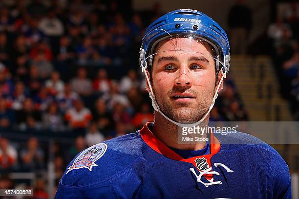 Johnny Boychuk of the New York Islanders skates against the Carolina Hurricanes at Nassau Veterans Memorial Coliseum on October 11 2014 in Uniondale...