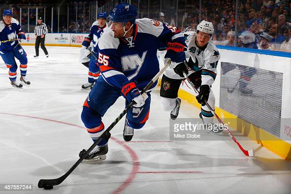 Johnny Boychuk of the New York Islanders skates against the San Jose Sharks at Nassau Veterans Memorial Coliseum on October 16 2014 in Uniondale New...