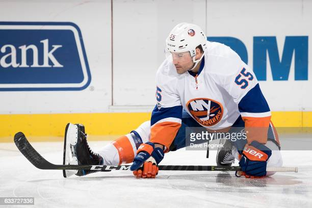 Johnny Boychuk of the New York Islanders stretches before an NHL game against the Detroit Red Wings at Joe Louis Arena on February 3 2017 in Detroit...