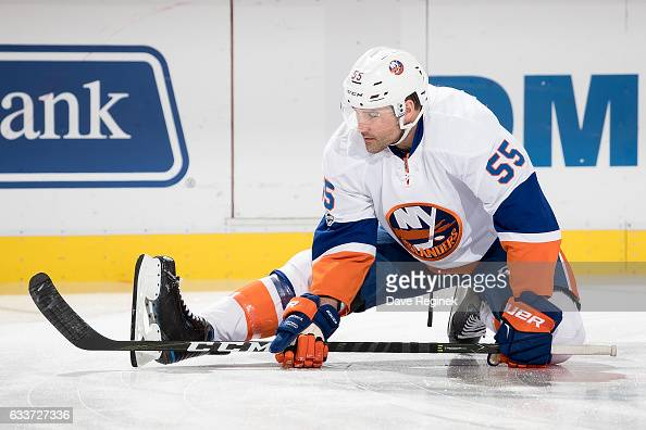 Johnny Boychuk of the New York Islanders stretches before his 1000th NHL game against the Detroit Red Wings at Joe Louis Arena on February 3 2017 in...