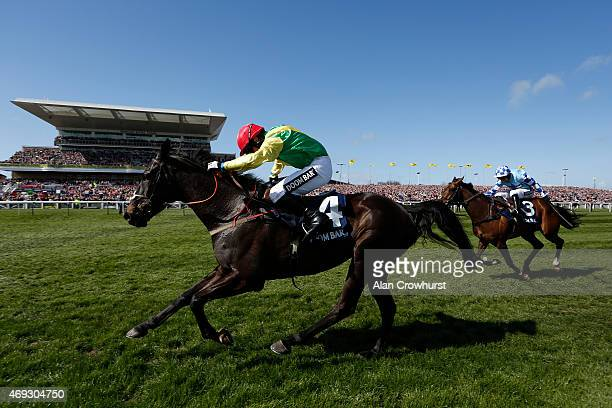 Johnny Burke riding Sizing Granite clear the last to win The Doom Bar Maghull Novices' Steeple Chase on Crabbie's Grand National day at Aintree...