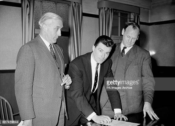 Johnny Byrne signs for West Ham United watched by manager Ron Greenwood and Crystal Palace manager Arthur Rowe