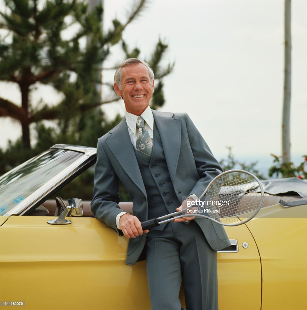 Johnny Carson Holding Tennis Racket